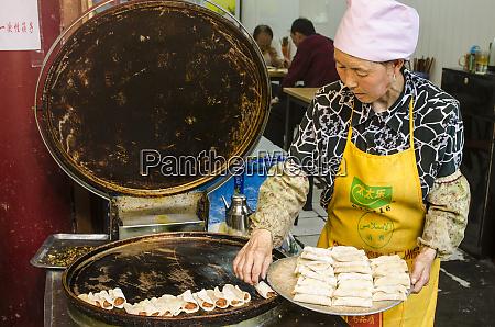 muslim hui woman preparing food muslim