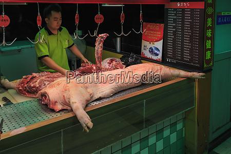 morning street market meat counter guangzhou