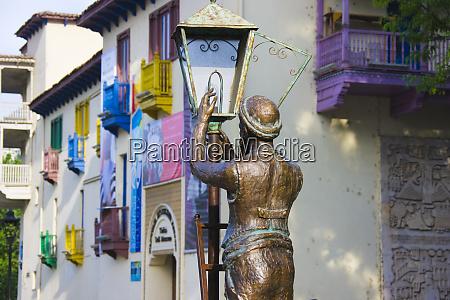 sculpture of man fixing light bulb