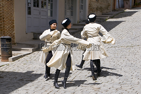 men dancing in traditional clothing sighnaghi