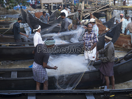 fishermen at work cochin kerala india