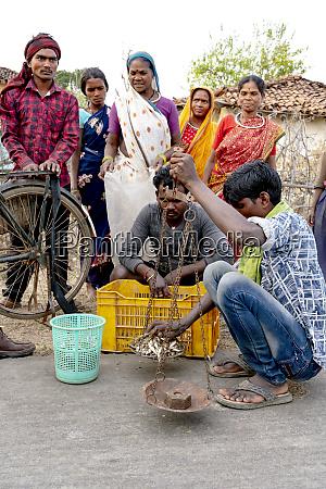 india madhya pradesh a man weighs