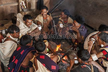 khiamniungan tribesman having tea nagaland india