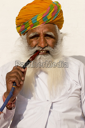 portrait of man smoking pipe mehrangarh