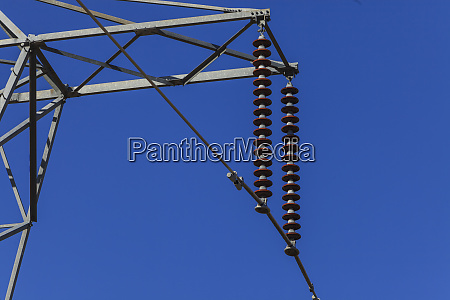 power lines on pylons near town