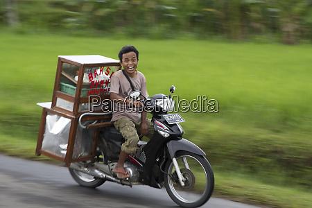 indonesia bali surprised motorbiker smile as