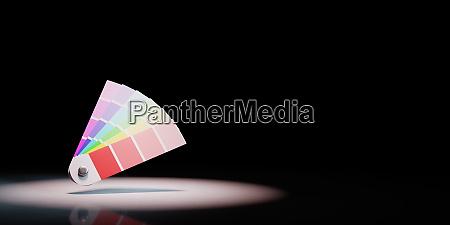 pantone colors sampler spotlighted on black
