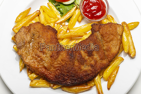 wiener schnitzel with french fries on