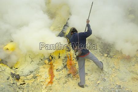 miner mining sulfur amid sulfur gas