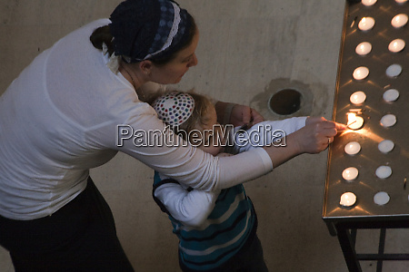 jewish mother helps her young son