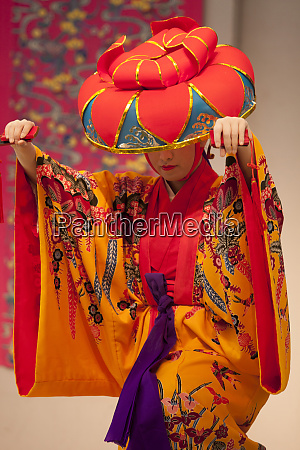 a female dancer in traditional clothing