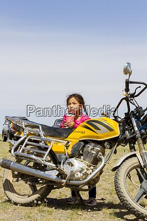 girl with motorcycle gobi desert mongolia