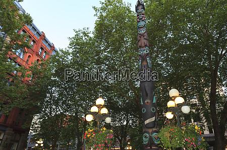 hanging flower baskets tlingit totem pole