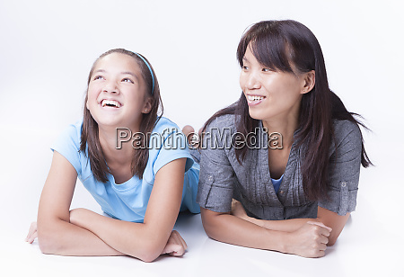 mother makes daughter laugh