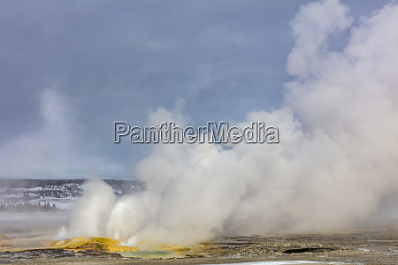clepsydra geyser in winter in yellowstone