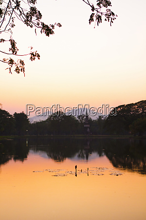 sunset over a lake in thailands