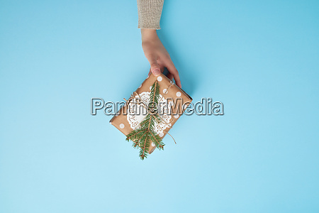 female hand holding a gift wrapped