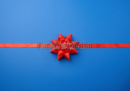 red silk ribbon and a large