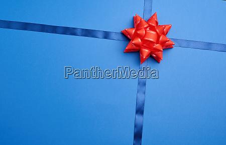 blue silk ribbon crossed on a