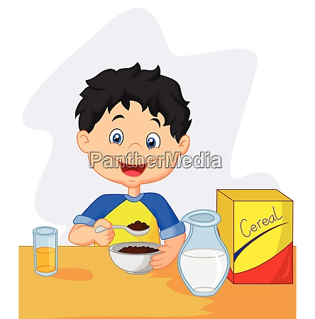 little girl having breakfast cereals with