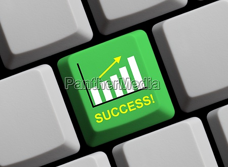 online success on green computer keyboard