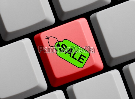 computer keyboard with tag showing sale
