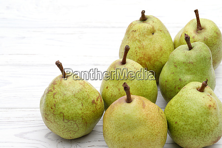 green ripe pear on a white