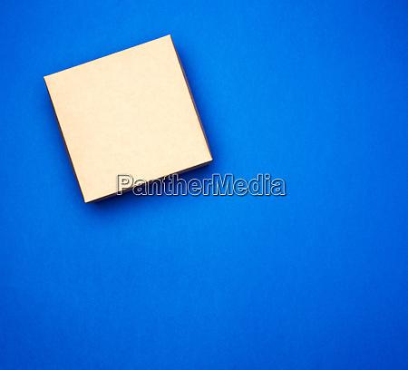 closed blue cardboard gift square box
