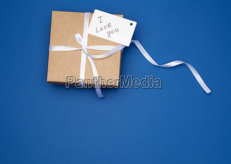 brown gift box with white bow