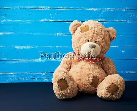 big beige teddy bear sitting on