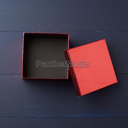 open empty red square cardboard box