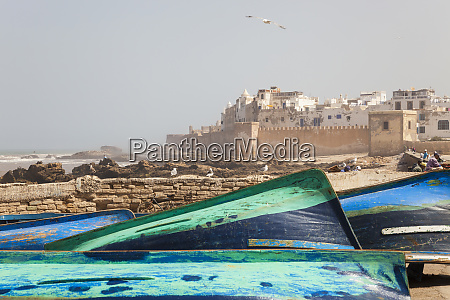 boats and city walls essaouira morocco