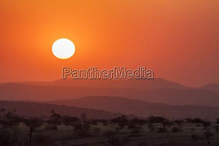 africa namibia damaraland orange sunset over