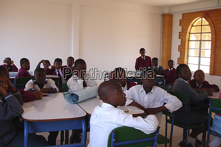 pupils in the classroom sitting at