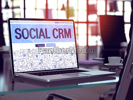 laptop screen with social crm concept