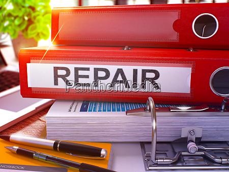 repair on red ring binder blurred