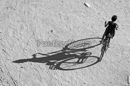 myamar bagan young boy riding a