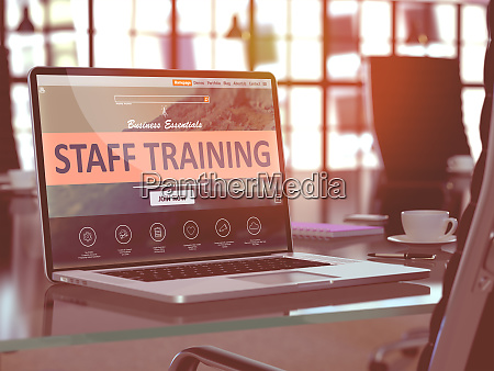 staff training on laptop in modern