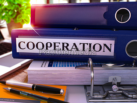 blue office folder with inscription cooperation