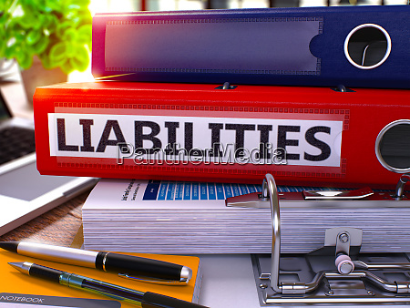 red office folder with inscription liabilities
