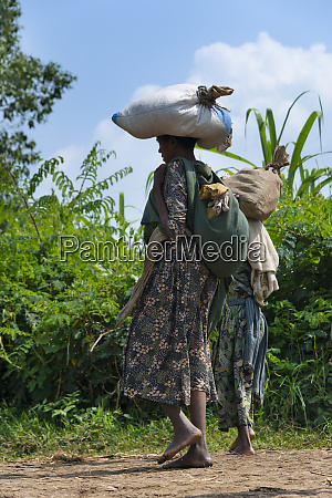 women carrying load on the head