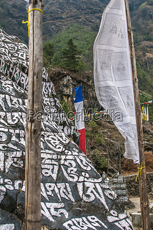 mani stones and prayer flags on