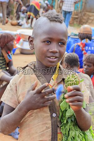 boy trading vegetables ethiopia africa