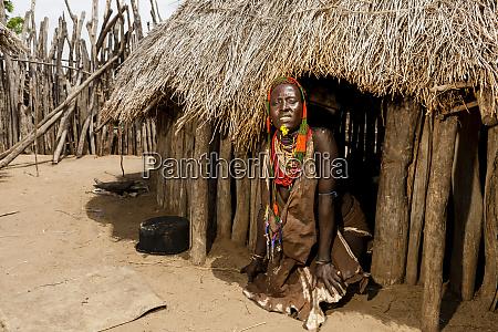 kara woman in hut entrance kolcho