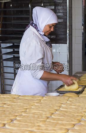 tangier morocco local woman baking bread