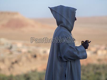 man using mobile phone morocco