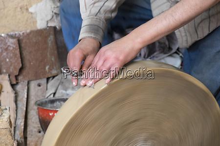 morocco fez medina craftsman sharpening scissors