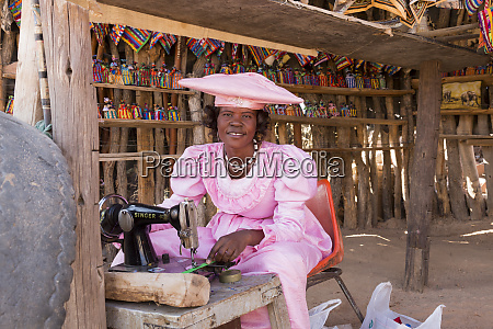 africa namibia herero tribe woman sewing