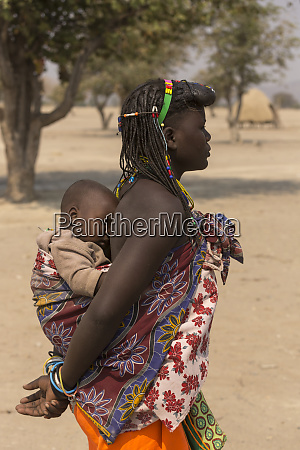 africa namibia young mother carries her