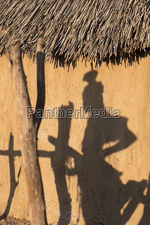 shadow of a himba woman on